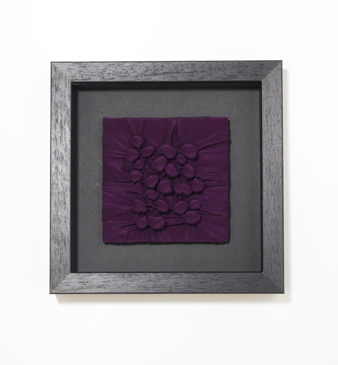 Image of small, framed textile.