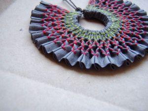 Smocked pendant by Tinctory