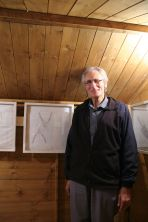 My dad alongside his dad's tools. Tool Shed stitched artworks by Ruth Singer. Displayed in Snibston as part of What's in Your Shed? exhibition