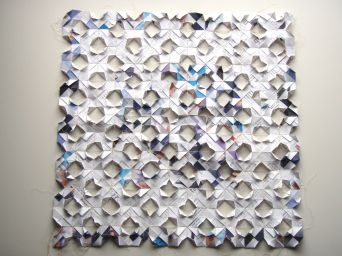 Small folded paper panel made from proof pages of my book Sew it Up.