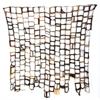 Quilt made from cloth in shades of brown with centres cut away from each small square, leaving seams only