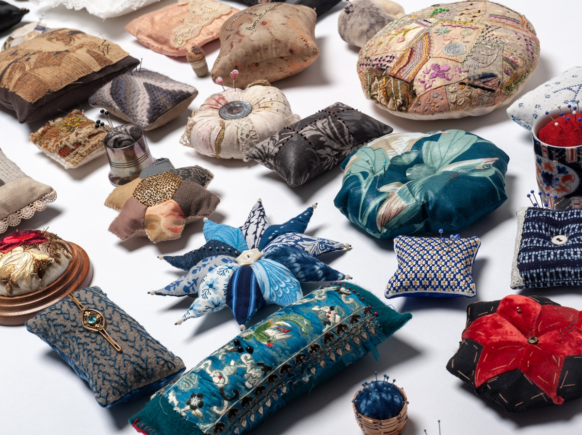 image of decorative pincushions arranged for exhibition