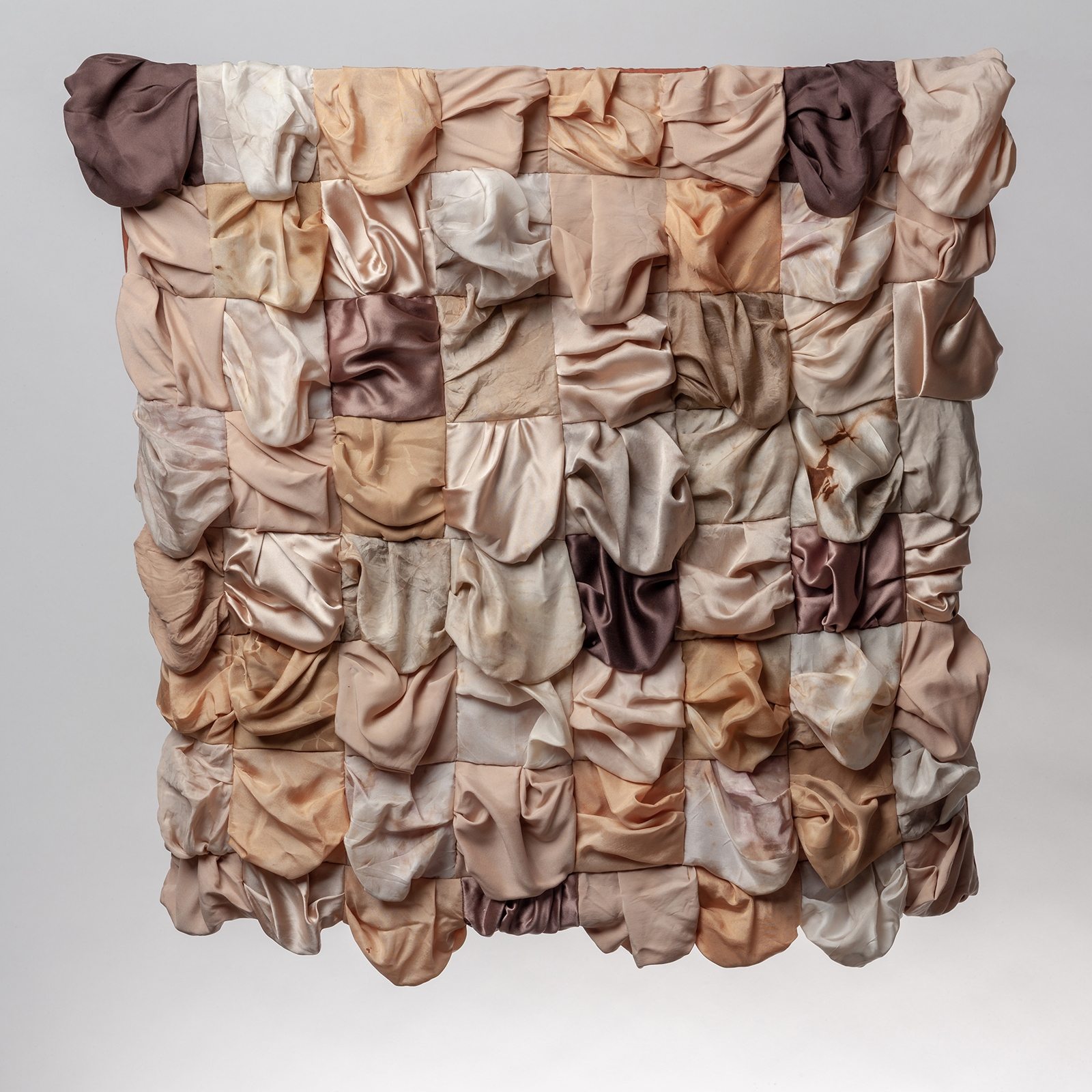 Textile quilt made from various flesh coloured silks, made to sag and drape