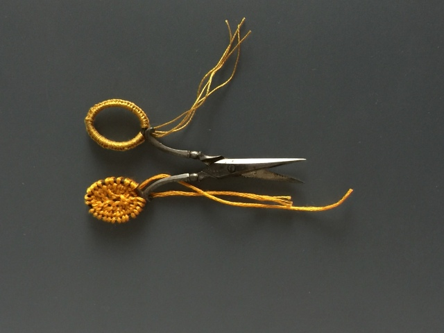 Antique scissors with stitching and embellishment by Ruth Singer.